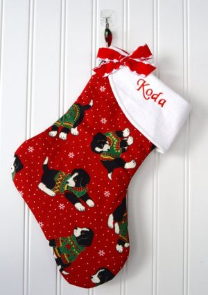ill a stocking full of yummy treats and fun toys for your favorite pup! Cute fabric choices!
